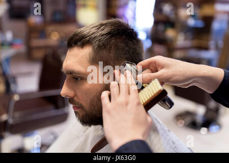 man and barber hands with trimmer cutting hair - Stock Photo