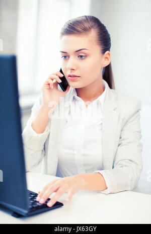 businesswoman with smartphone in office - Stock Photo