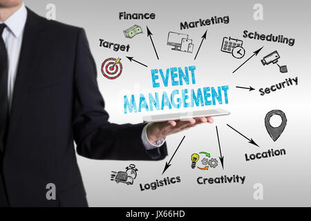 Event management concept with young man holding a tablet computer. - Stock Photo