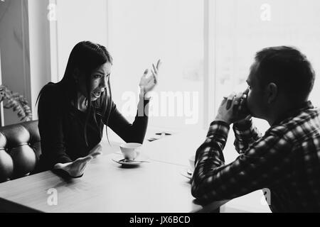 Man and woman in discussions in the restaurant - Stock Photo