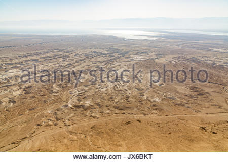 View of the eroded plain leading from Masada and surrounding mountains to the Dead Sea in Israel. - Stock Photo