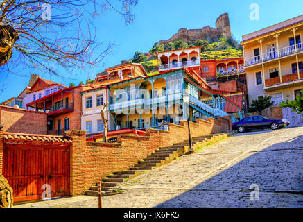 Traditional carved balconies and colorful wooden houses in the Old Town of Tbilisi, Georgia - Stock Photo