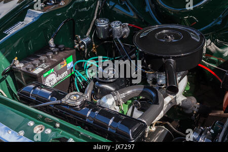 The engine of a green Mark 1 Ford Cortina is pictured in Penrith, North West England whilst parked. - Stock Photo