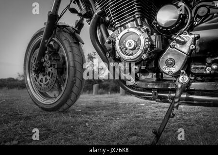 A close up shot of a custom made motorbike in black and white - Stock Photo