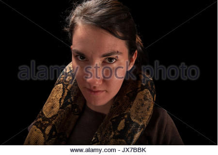 A young woman holds a red-tailed boa constrictor, Boa constrictor constrictor, at the Lincoln Children's Zoo. - Stock Photo