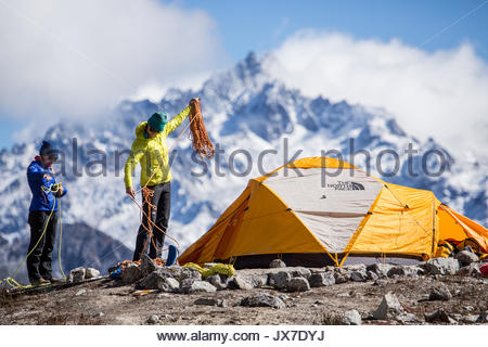 Expedition members check climbing ropes and gear prior to setting out on a mountaineering expedition. - Stock Photo