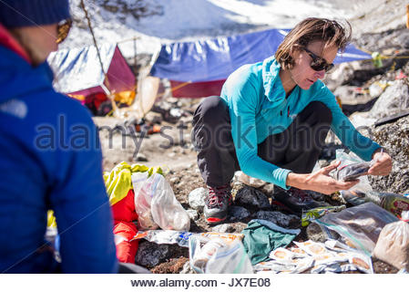 Expedition members check gear. - Stock Photo
