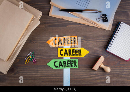 Career concept. Paper signpost on a wooden desk. - Stock Photo
