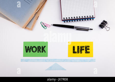 Work Life Balance concept. Paper scale on a white table. - Stock Photo