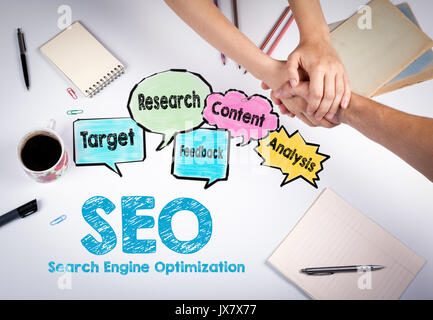 SEO Search Engine Optimization concept. The meeting at the white office table. - Stock Photo