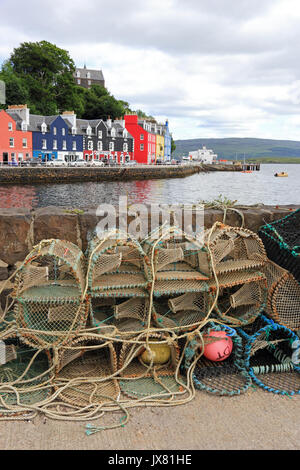 Crab pots and colourful houses on harbourside, Tobermory, Isle of Mull, Scotland - Stock Photo