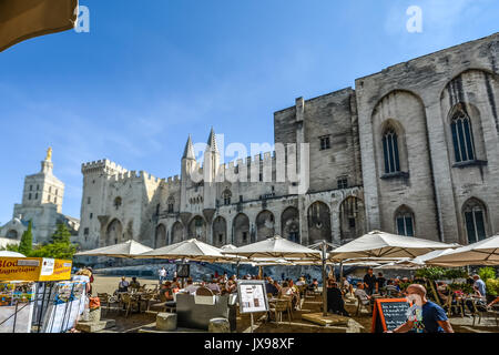 sidewalk cafe in front of the palais des papes and the cathedral stock photo 19222864 alamy. Black Bedroom Furniture Sets. Home Design Ideas