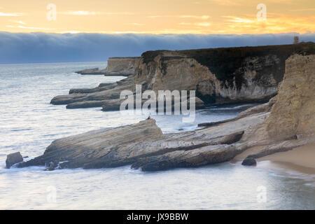 Foggy Sunset Coastline - Stock Photo
