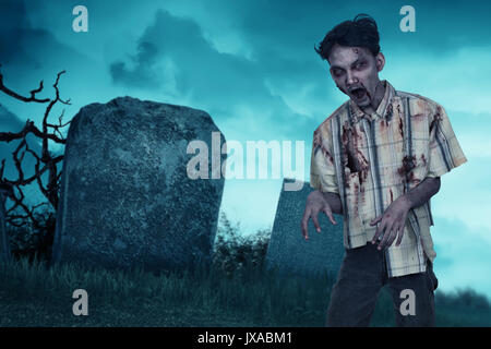 Bloody asian zombie man with wound in the body standing on the graveyard - Stock Photo