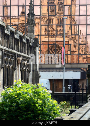 Hull Minster Reflected in a Modern Building in the Old Town Hull Yorkshire England - Stock Photo