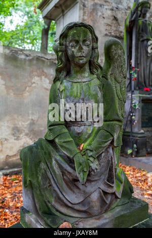 Antique stone statue  of little girl on famous old Olsanske cemetery in Prague, Czech Republic. - Stock Photo