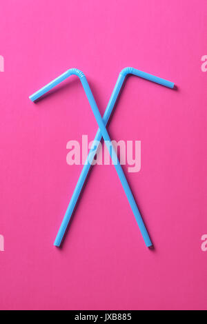 Flat lay concept: drinking straw for party or celebration on trendy pink pastel background. Summer is coming concept. - Stock Photo