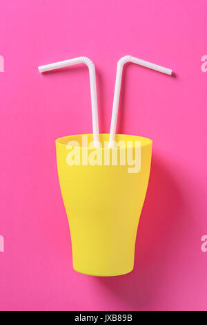 Flat lay concept: plastic cup and drinking straw for party or celebration on trendy pink pastel background. Summer - Stock Photo