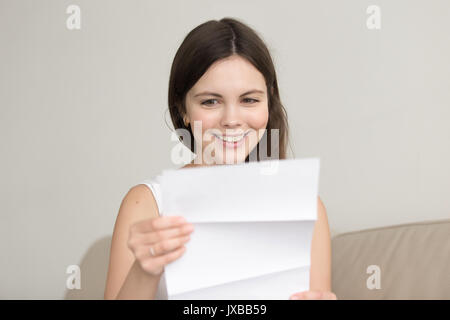 Surprised woman reading letter with unexpected good news, feelin - Stock Photo