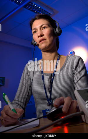 Michelle Davidson (Queen's Nurse) doing out-of-hours telephone triage at the GP Clinic, based at Weston General - Stock Photo