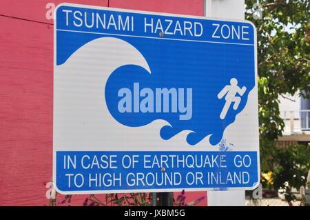 Tsunami Hazard Zone sign in Blue and White - Stock Photo