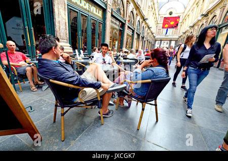 Brussels, Belgium. People sitting at cafe tables in Galeries Royales Saint-Hubert / Koninklijke Sint-Hubertusgalerijen - Stock Photo