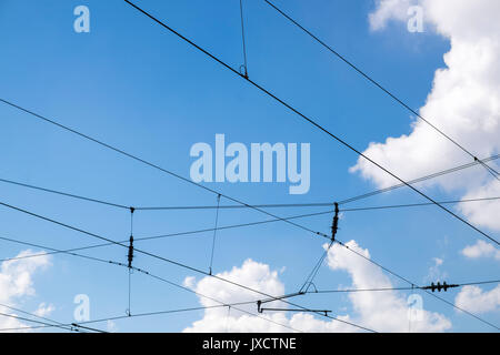 Overhead electric wires  that provide power for the railway trains - Stock Photo