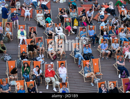 French Open 2017 Feature,Spectators sitting in deck chairs. - Stock Photo