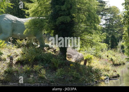 Iguanodon statues in the dinosaur area at Crystal Palace Park, London - Stock Photo
