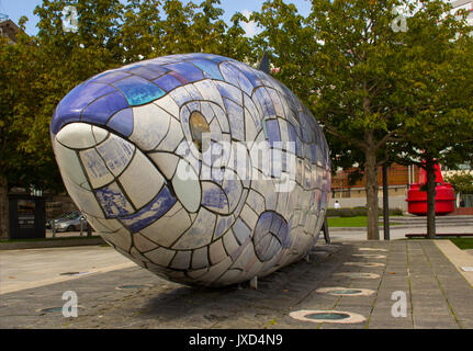 The large colourful fish sculpture Salmon of Knowledge in the pedestrian zone on the Donegall Quay in Belfast's - Stock Photo