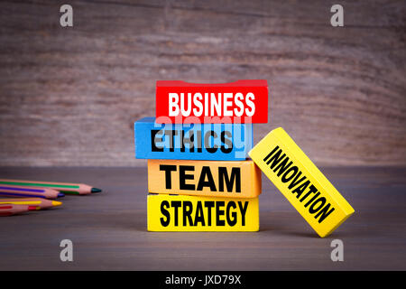 business concept. Colored wooden blocks on the table. - Stock Photo