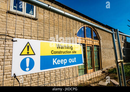 'Warning, construction site, keep out' sign in Langtoft, near Peterborough, Lincolnshire, England, UK.