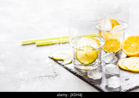 Empty glasses on a slate for drinks. - Stock Photo