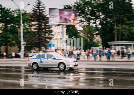 Minsk, Belarus - June 28, 2017: Traffic Road Police Car Moving In Town Street At Rainy Summer Day. - Stock Photo
