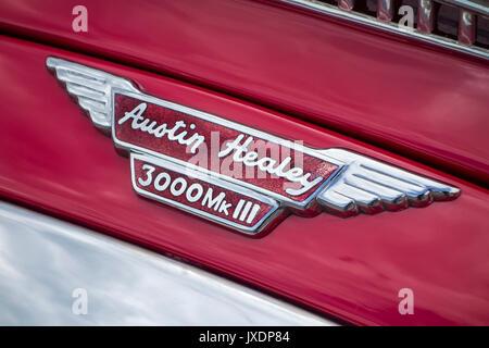 British red classic sports car Austin-Healey 3000 MkIII / Mark III badge logo - Stock Photo