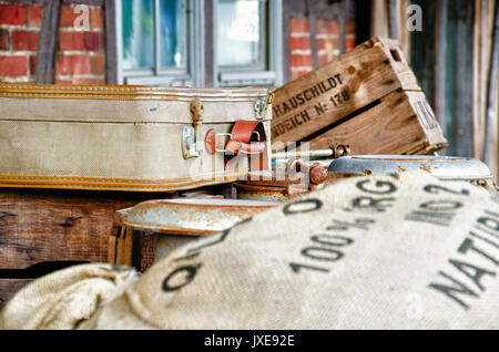 Vintage and retro - Suitcase, grain bags, metal barrel and wooden box - Stock Photo