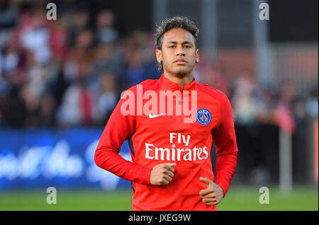 Paris Saint-Germain's Brazilian forward Neymar runs during the French L1 football match Paris Saint-Germain (PSG) - Stock Photo