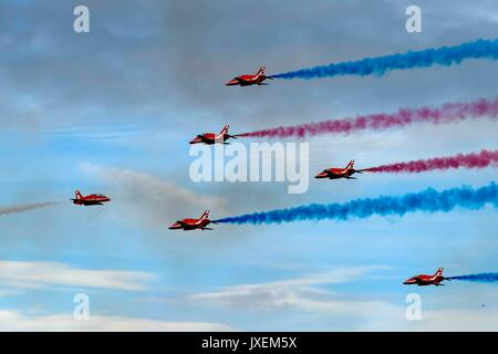 Weymouth, Dorset, UK. 16th Aug, 2017. The RAF Red Arrows performing their acrobatic display over the seaside resort - Stock Photo