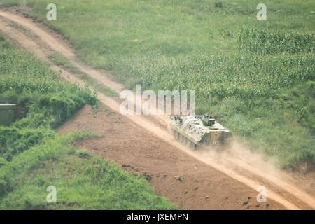 Haichung, China. 16th Aug, 2017. People's Liberation Army soldiers maneuver in an armored personal carrier during - Stock Photo