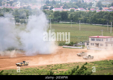 Haichung, China. 16th Aug, 2017. People's Liberation Army soldiers maneuver in WZ531 armored personal carriers during - Stock Photo