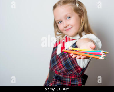young apprentice with a bright pencils - Stock Photo