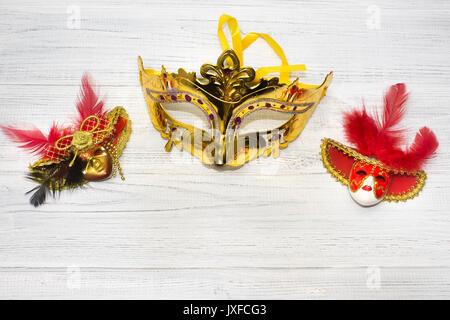 Venice masks on wooden background - Stock Photo