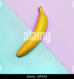 Fruit in flat lay Ripe yellow banana is lying on two-tone background Top view Trendy colorful flat lay photo of - Stock Photo