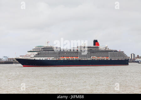 Cunard cruise liner Queen Victoria is pictured on the River Mersey as part of celebrations to mark Cunard's 175th - Stock Photo