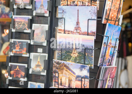 PARIS, FRANCE - JUNE 07, 2017: : Various postcards from Paris displayed at souvenir shop - Stock Photo