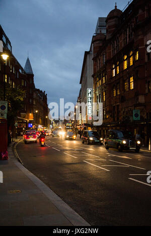 Variety of vehicles travelling along a busy Shaftesbury Avenue, London with Palace Theatre which showed Harry Potter - Stock Photo