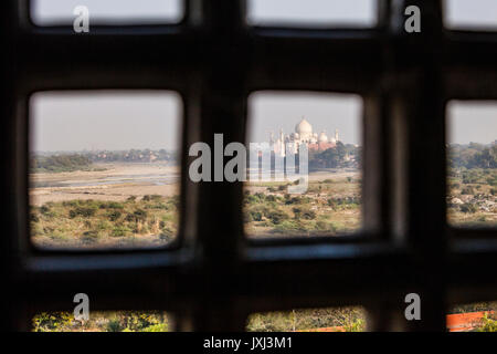 Looking at the Taj Mahal  through a window in the Agra Fort in Agra, Uttar Pradesh, India. This is the view Shah - Stock Photo