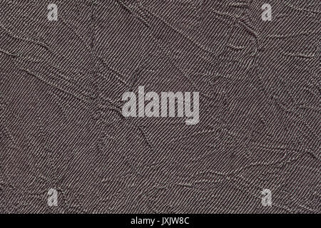 Dark gray wavy background from a textile material. Fabric with fold texture closeup. Creased shiny brown cloth. - Stock Photo