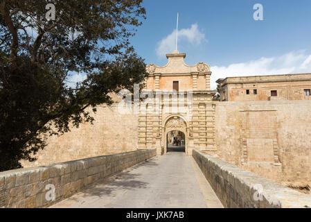 A stone gateway into the walled city of Mdina Malta - Stock Photo