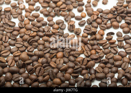 Coffee beans on a white background. this food is used for making coffee, which is an energy drink. - Stock Photo
